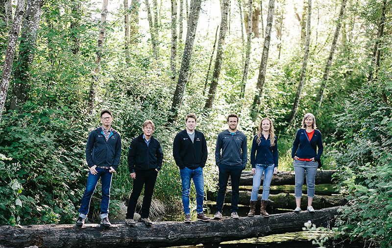 staff standing on a log