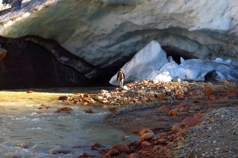 Worker at the toe of a glacier